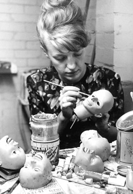 Judith working on puppet heads